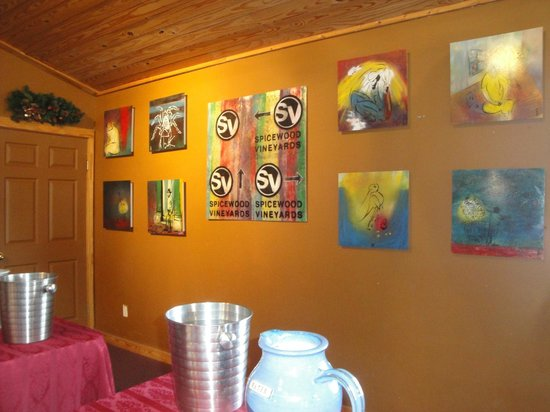 Spicewood Vineyards: Vineyard tasting room's wall of local artists' interesting, colorful oil paintings