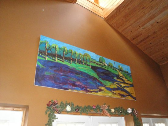 Spicewood Vineyards: Wall mural over the tasting room's doorway ~ bold blues, teal greens, & purples oil paints.