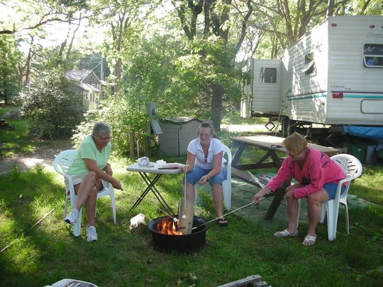 Sippewissett Campground and Cabins: Campfire at Trailer site at Sippewissett Cabins & Campground