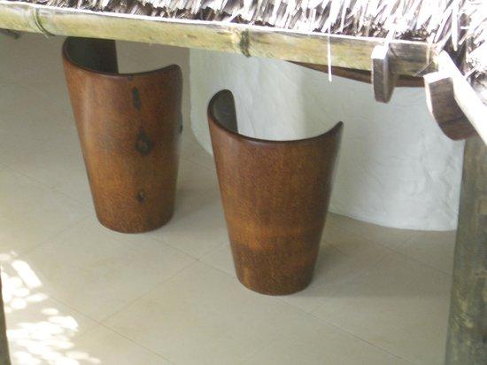 Soneva Fushi Resort:                   Spa lobby at Soneva. Chairs made from palm tree trunks!