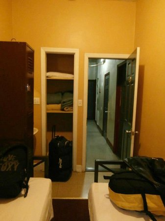 Chelsea International Hostel:                   Our room looking to the hallway and shared bathroom on the right in hall     