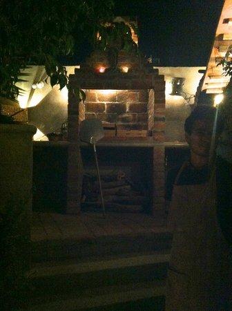 Casa Dahlia: The garden's wood-burning oven