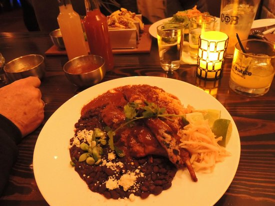 Casa del Barco:                   Rabbit mole with black beans, jicama slaw & rice