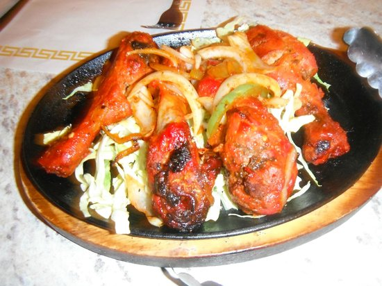 India Oven:                   sizzling tandoori chicken served to your table