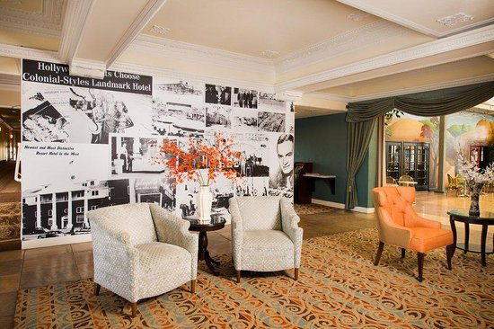 The Lafayette Hotel, Swim Club & Bungalows: Lobby with Historic Photos on Wallpaper