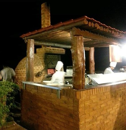 Wood Fired Pizza Oven And Outdoor Kitchen Between The Pool