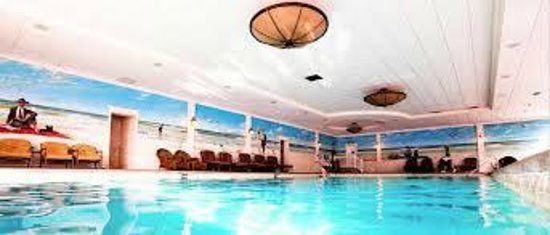 The Grand Hotel: Heated Indoor Pool & Relaxing Chaise Lounge Chairs