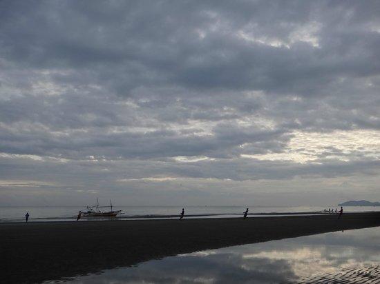 Baybay Beach :                   Fishermen hauling in their catch.