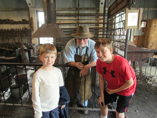 Empire Mine State Historic Park: Evan and Adam Hansen with Hal, the ring blacksmith