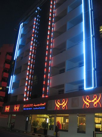 Xclusive Hotel Apartments: hotel lit up at night