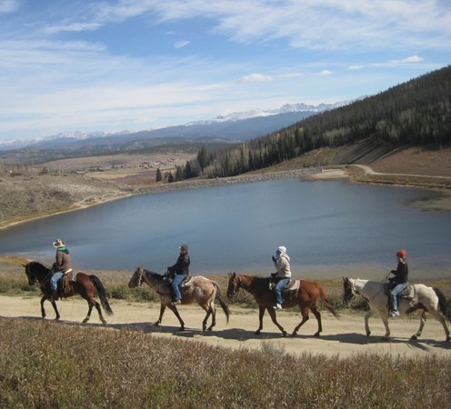 Sombrero Stables at Snow Mountain Ranch: Year-Round Trail Rides! Here the Reservoir with the Continental Divide providing a stunning back