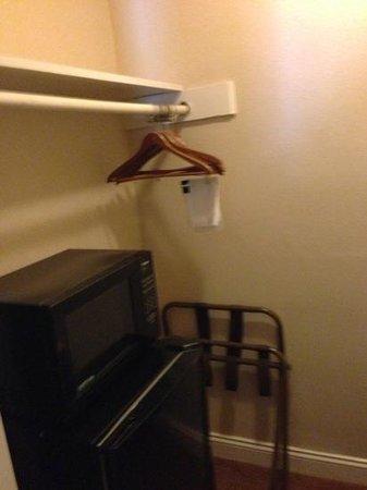 Ambassador Inn :                   fridge, microwave & iron located in closet.