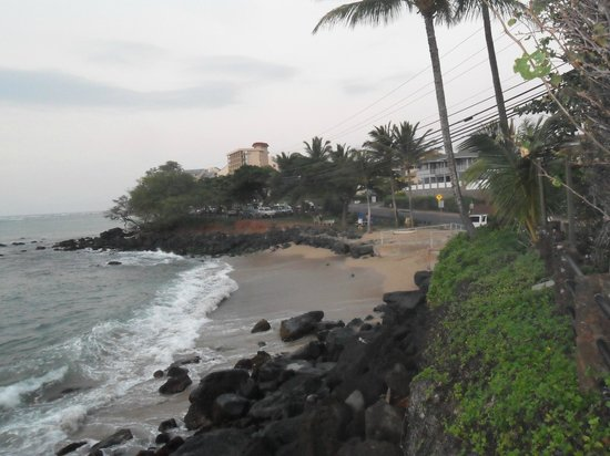 Noelani Condominium Resort:                   Beach area where locals drink and surfers gain access to water