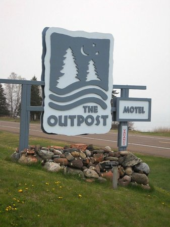 The Outpost Motel: Outpost sign