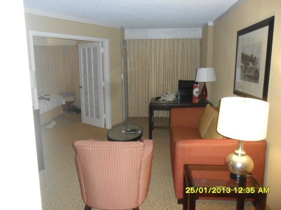Chicago Marriott Suites O'Hare:                   Living area with work desk and TV