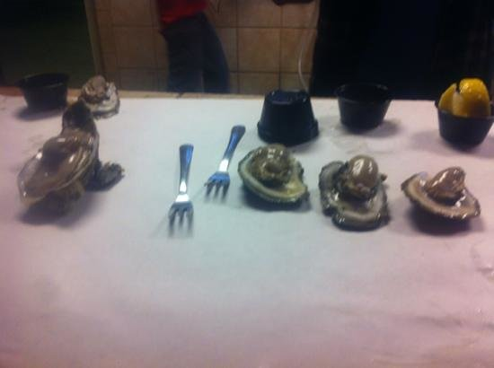 Victorio's Oyster Bar and Grille:                   Oysters by the bucketload, shucked and ready to eat with all the condiments! D