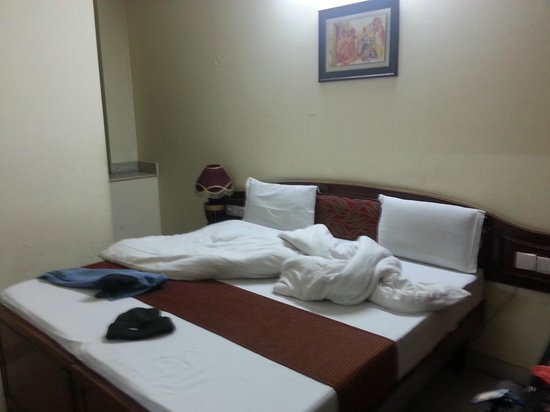 Indraprastha Hotel: Room 103. comforter found on bottom of wardrobe
