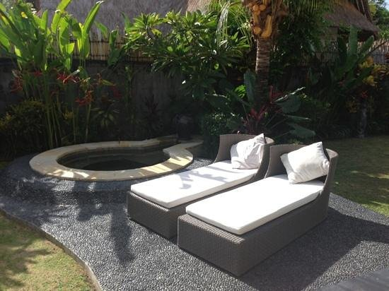 Villa Seminyak Estate & Spa:                   jacuzzi and sun loungers in our private garden