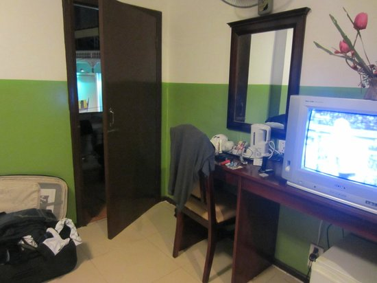 VIP Star Hotel:                   Desk, TV, and door leading to the balcony