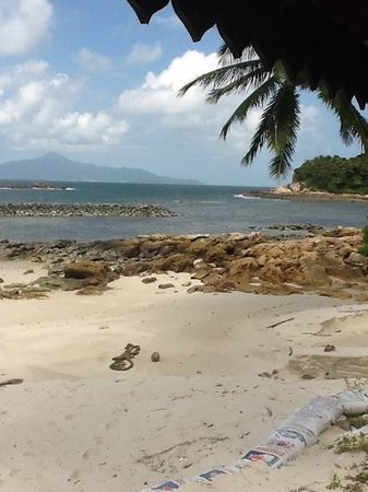 Sibu Island Resort:                   view if Pulau Tinggi from Beach 2