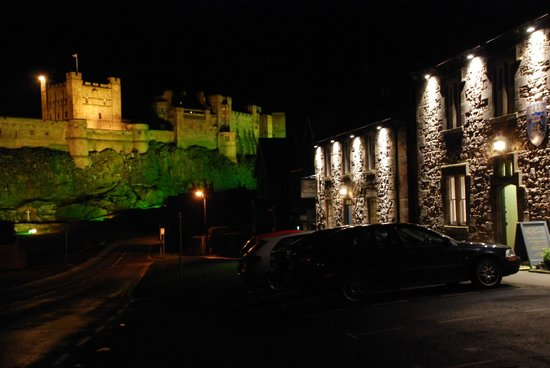 The Lord Crewe Hotel & Restaurant: The Lord Crewe by night, with Bamburgh castle in the background.