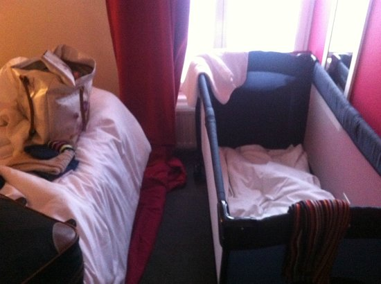 Hotel Soft:                   Inside the cosy room with the baby cot