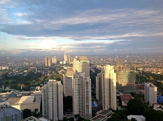 HARRIS Suites FX Sudirman:                                     Jakarta 6am from harris hotel 43rd floor. Wicked! love the v
