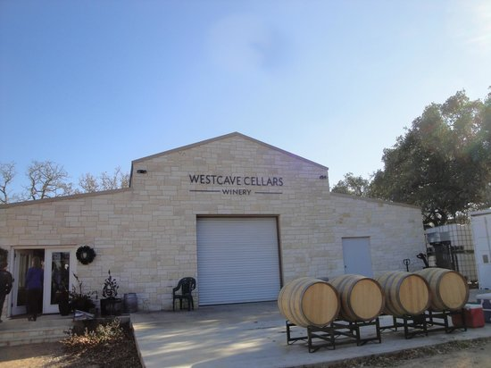 Hefty facade & bulky wine barrels of the Winery's stucco