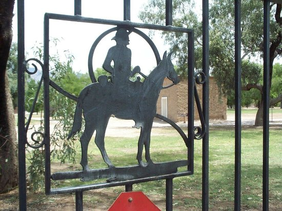 Fort Lowell Museum:                   Wrought-iron cavalryman on front gate.