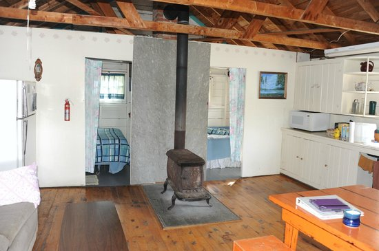 "Bruce Bay Cottages: ""Great room"" with sleeping cubicles and the woodstove"