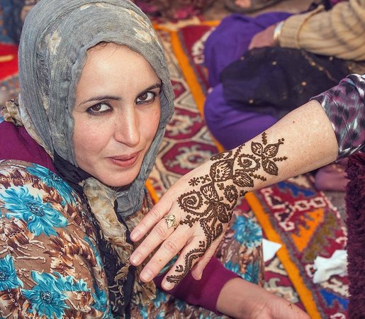 Travel Exploration Morocco Private Tours:                   Wife gets Henna in Berber Village