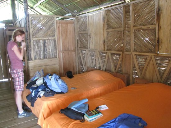 Dolphin Lodge Uaguinega:                   bedroom with open slats to allow a cool breeze to blow all the time