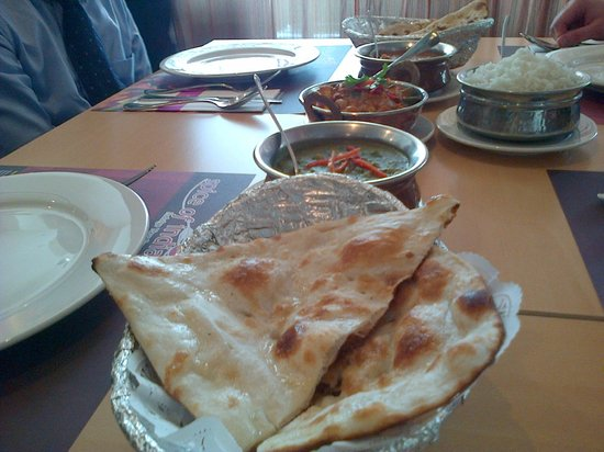 Spice of India :                   The food on our table. Note no infused garlic in these naans