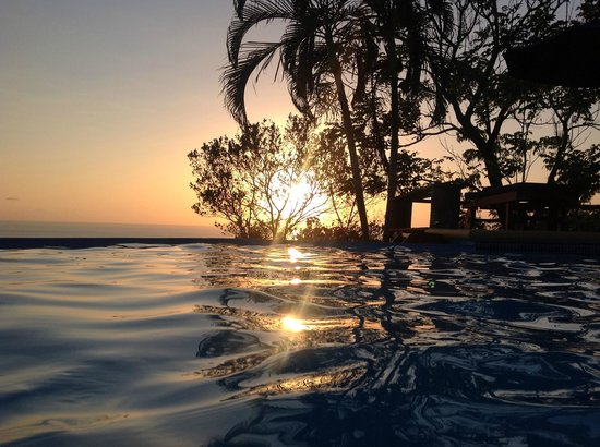 Sunset in the pool at Cristal Azul! Tropical fresh fruit drink anyone?  Rum optional!