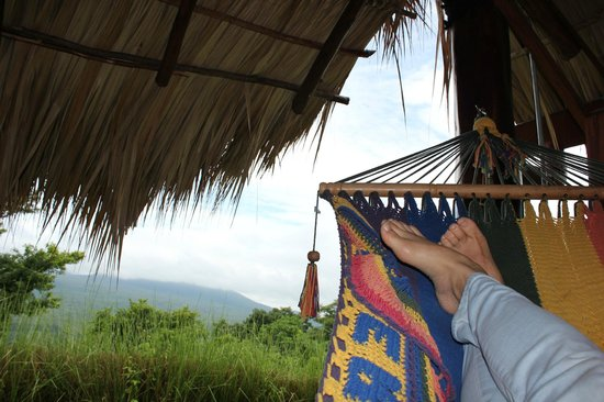 Hacienda Puerta Del Cielo Eco Spa:                   Relaxing on the hammock outside of our casa