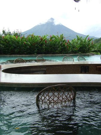 The Springs Resort and Spa:                   My seat at the pool bar.  Breaktaking view of Arenal.