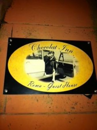 Chocolat Inn:                                     Close up of the sign for the place.