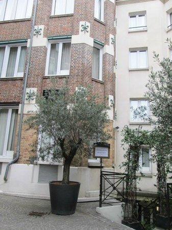 Hotel Les Jardins du Marais: façades intérieures