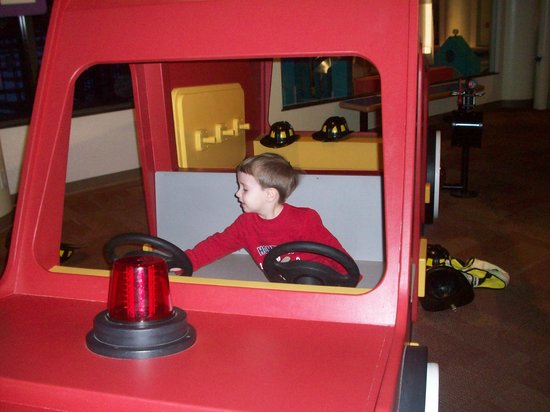 "Imagination Station:                                     My son ""driving"" the fire engine"