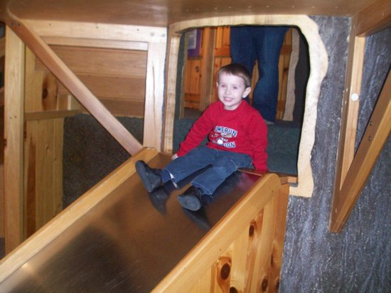 Imagination Station:                                     in the playhouse on the slide