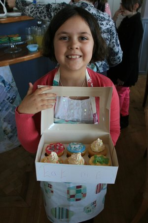 Berry's Eatery:                   amy delighted with her cupcakes
