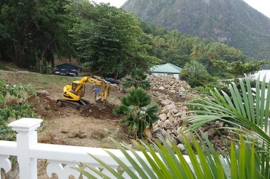 Sugar Beach, A Viceroy Resort:                   The idyllic view of an excavator loudly moving bolders next to our villa