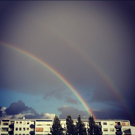 Pink Iceland Day Tours : Double Rainbow over Reykjavik!