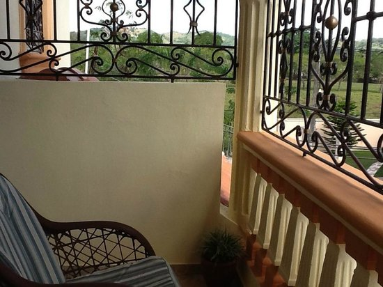 Miguelina's Guest House :                   from 2nd floor porch to fields and hills at end of street