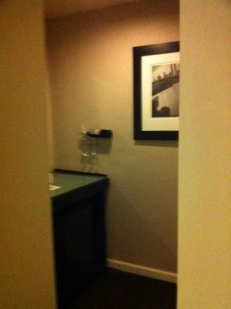 The Court – A St Giles Hotel:                   Minibar and closet area