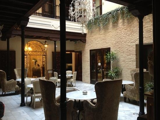 Hotel Casa 1800 Sevilla:                   Tea and breakfast courtyard. lovely...
