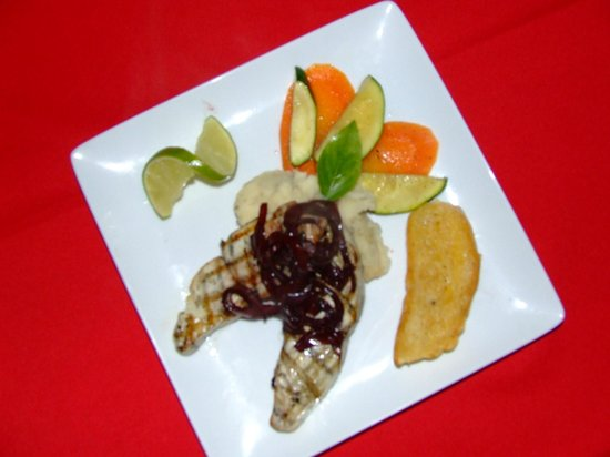 Port Side Restaurant and Bar : Grilled wahoo with sweet onion red wine reduction, roasted garlic potato puree, sauteed veg.