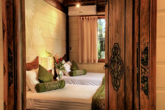 Pranamar Villas and Yoga Retreat: Balinese antique doors to bedroom