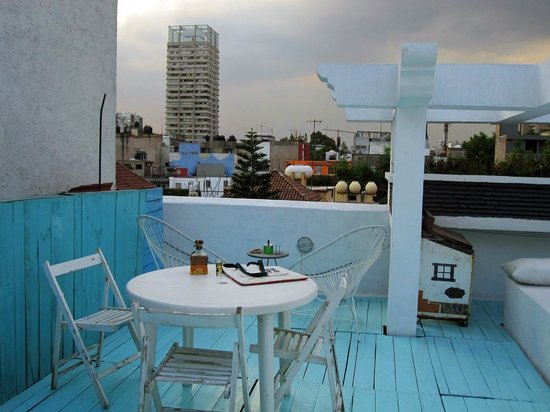 Condesa Haus:                   the root top, complete with tequila and a sunset