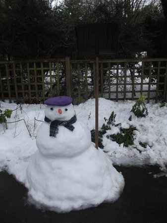 9 Green Lane:                   Snowman Made By Another Guest Outside Our Room